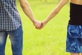 Couple hands closed together in summer — Stock Photo