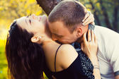 Happy young couple kissing — Стоковое фото
