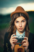 Beautiful hipster girl shooting — Stock Photo