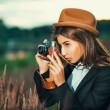 Beautiful hipster girl shooting — Stockfoto
