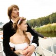 Beautiful bride and groom on a ship — Stock Photo