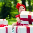 Joyful kid girl with colorful gift boxes — Stock Photo