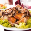 Plate with roasted chicken — Stock Photo