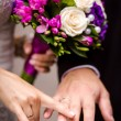 Bride and groom holding hands — Stock Photo #31063469