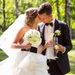 Stock Photo: Young bride and groom kissing