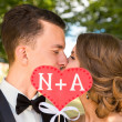 Young bride and groom kissing — Stock Photo