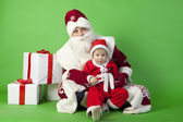 Father and son wearing Santa costume — 图库照片