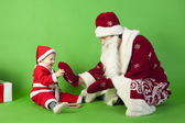 Father and son wearing Santa costume — Stock Photo