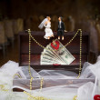 Figurines of the sitting bride and groom — Stok fotoğraf