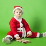 Beautiful boy wearing Santa costume — Stock Photo #36108447
