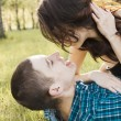 Young happy couple kissing — Stock Photo #38597887