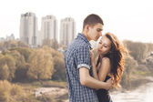 Beautiful young couple embracing — Fotografia Stock