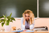 Tired teacher checking the tests. — Stock Photo