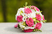 Wedding bouquet of red white roses — Stock Photo