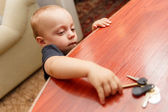 Child is trying to steal the keys — Stock Photo
