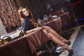 Pretty woman in nightclub — Stock Photo
