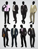 Eight businessman silhouettes — Stock Vector