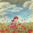 Cute little girl in the poppy field — Stock Photo