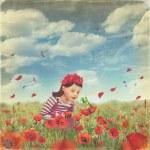 Cute little girl in the poppy field — Stock Photo #12563210