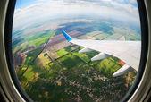 View through airplane porthole — Stock Photo
