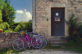 Bicycles parked in front of a rustic house ,France — Stock Photo