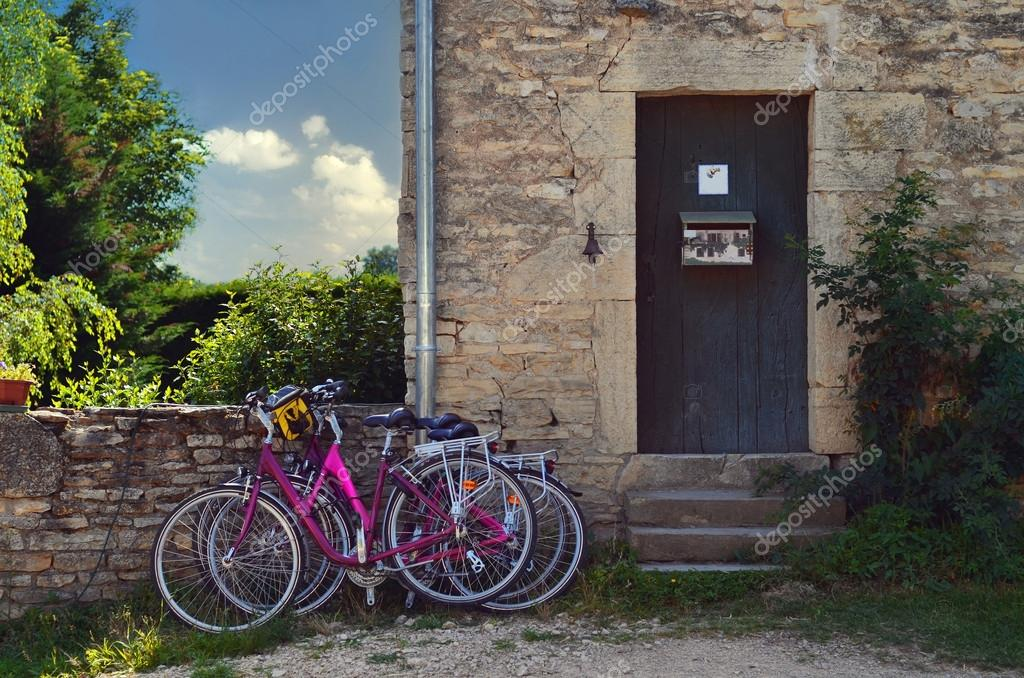 Bicycles parked in front of a rustic house ,France — Stock Photo #13192314