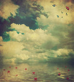 Sea landscape. Old postcard: design in grunge and retro style  with roses petals — Stock Photo