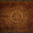 Pattern of mandala carved on wood - Stock Photo