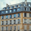 View of Unique traditional French windows and balconies. Paris, — Stock Photo