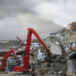 Crane dismantling building — Stock Photo