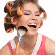 Stock Photo: Womin hair rollers