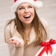 Santa girl and snowflakes — Stock Photo #36600491