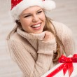Santa girl and snowflakes — Stock Photo #36600555