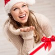 Santa girl and snowflakes — Stock Photo