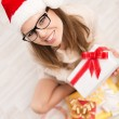 Santa girl with Christmas gift — Stock Photo