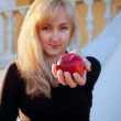 Beautiful girl and red apple — Stock Photo