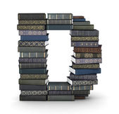 Letter D, stack of books — Stock Photo