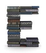 Letter E, stack of books — Stock Photo