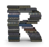 Letter R, stack of books — Stock Photo