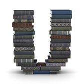 Letter U, stack of books — Stock Photo