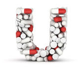 Letter U, alphabet from pills — Stock Photo