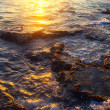 Rocky sea coast on sunset - Stock Photo