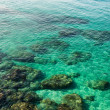 Emerald green sea water with rock  on Cyprus island — Стоковая фотография