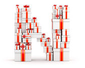 Letter N from boxes of gifts decorated with red ribbons — Stock Photo