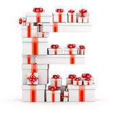 Letter E from boxes of gifts decorated with red ribbons — Stock Photo