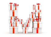 Letter from boxes of gifts decorated with red ribbons — Stock Photo