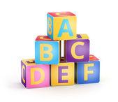 A、 b、 c 的多维数据集金字塔 — 图库照片