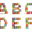 Alphabet on a baby cubes letters — Stock Photo