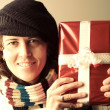 Woman with Christmas present — Stock Photo