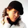 Stock Photo: White woman portrait pose and intense look with white and black cap sweatter